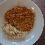 Instant pot vegan lentil dal on plate with brown rice