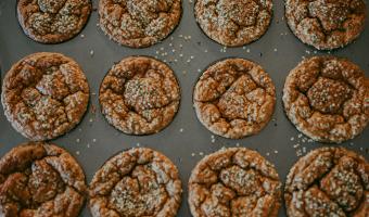 Hemp heart topped muffins in muffin tin
