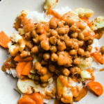 Green curry chickpea stir-fry served on a plate