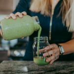 Green smoothie pouring from mason jar